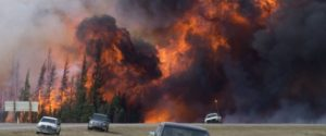 A giant fireball is seen as a wildfire rips through the forest along Highway 63, 16kilometres south of Fort McMurray, Alta., Saturday, May 7, 2016. Wildfire experts say dangers from the Fort McMurray fire won't end when the flames stop.Officials from California, where wildfires burn residential areas every summer, say ash left behind in a city is considerably more dangerous than ash from a burned forest.THE CANADIAN PRESS/Jonathan Hayward